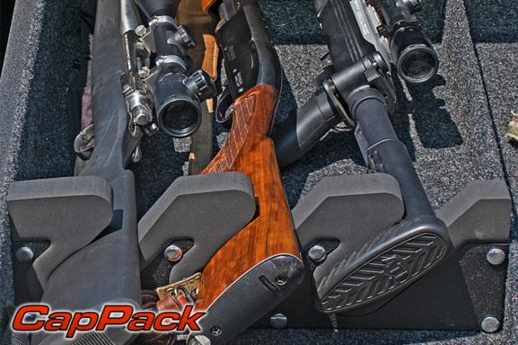 guns in the loadmaster cap pack gun holder