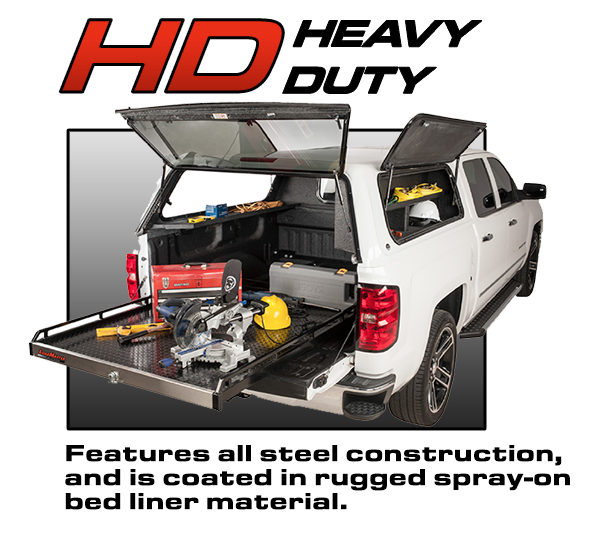 Loadmaster Heavy Duty Cargo Management System hauling construction equipment