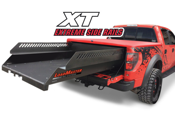 Red ford raptor with a loadmaster xt cargo slide with high side railing